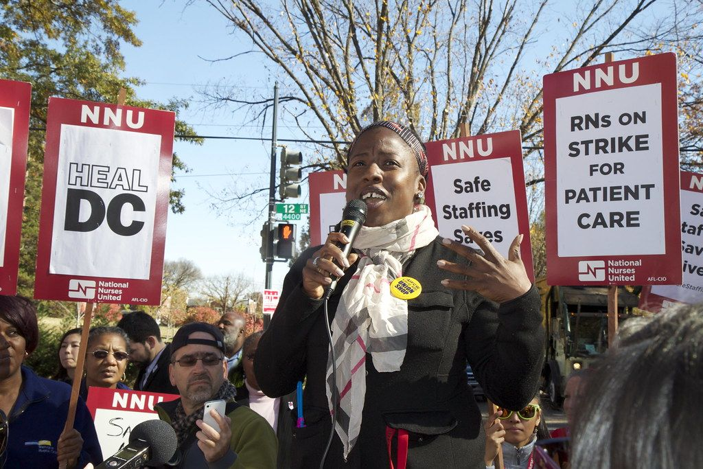 A union member gives a speech at a strike.