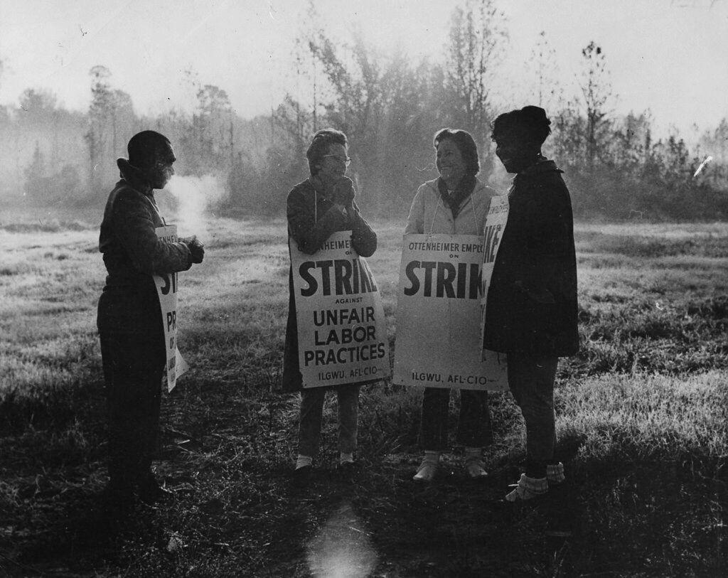 Four women on strike chatting.